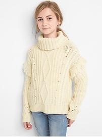 Fringe cable knit turtleneck sweater