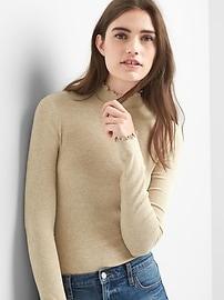 Col roulé à volants en tricot côtelé