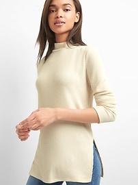 Pull à col montant en tricot côtelé au fini soyeux