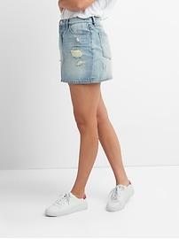 Mini-jupe à cinq poches en denim d'aspect usé